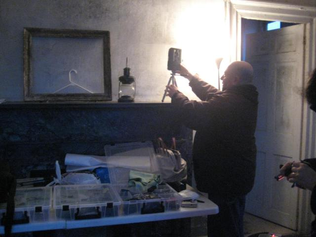 Gerard setting up a motion activated camera and the standard tool kit of the Seekers Club of the Paranormal