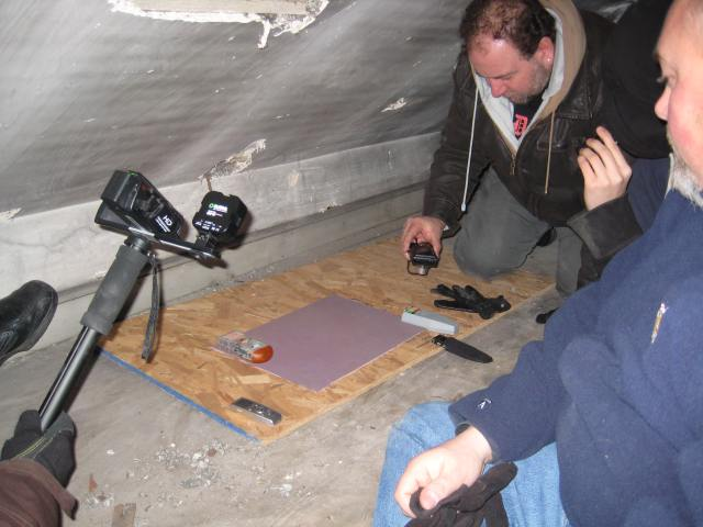 Anthony, Joey, and Gerard conducting EVP session with heat signature pad, audio-visual recording devices, and EMF meters